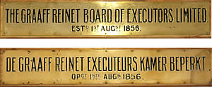 The brass name plates that hung on the original building in 1856